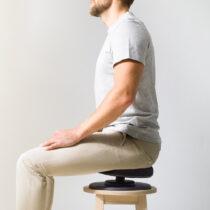 Posture Balance Balanssits man sitter och balanserar på pall